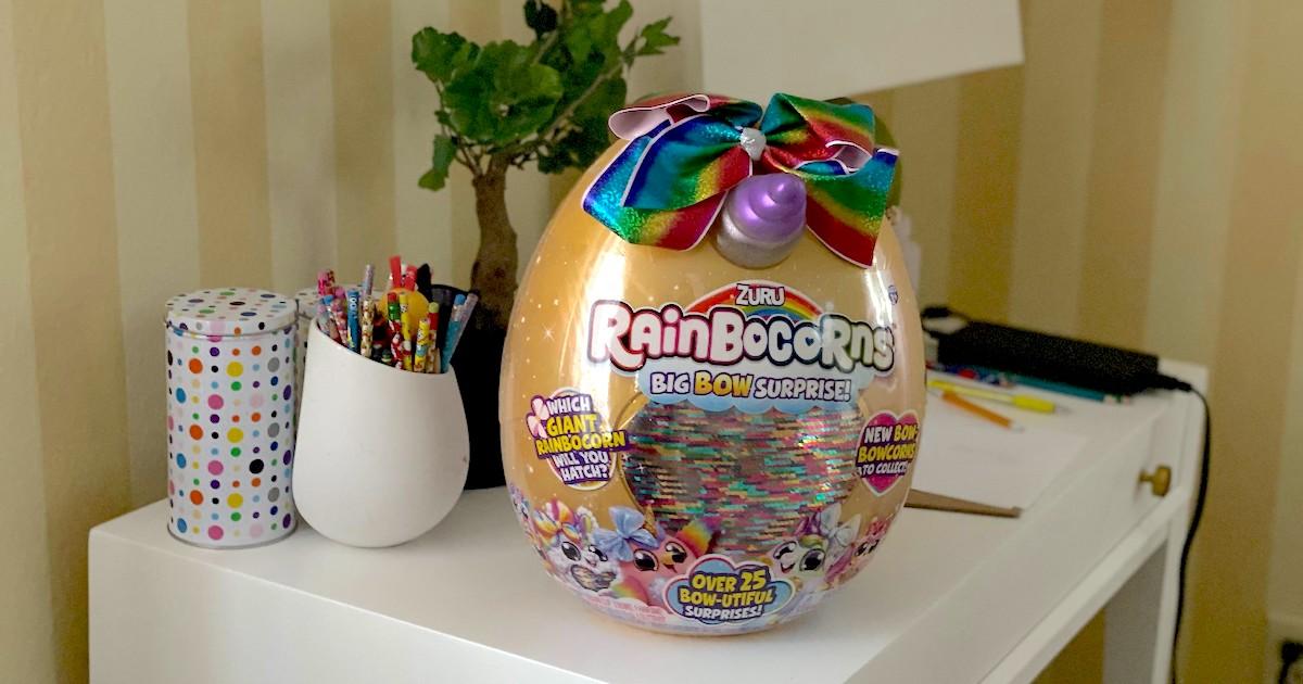 golden rainbow unicorn egg sitting on desk