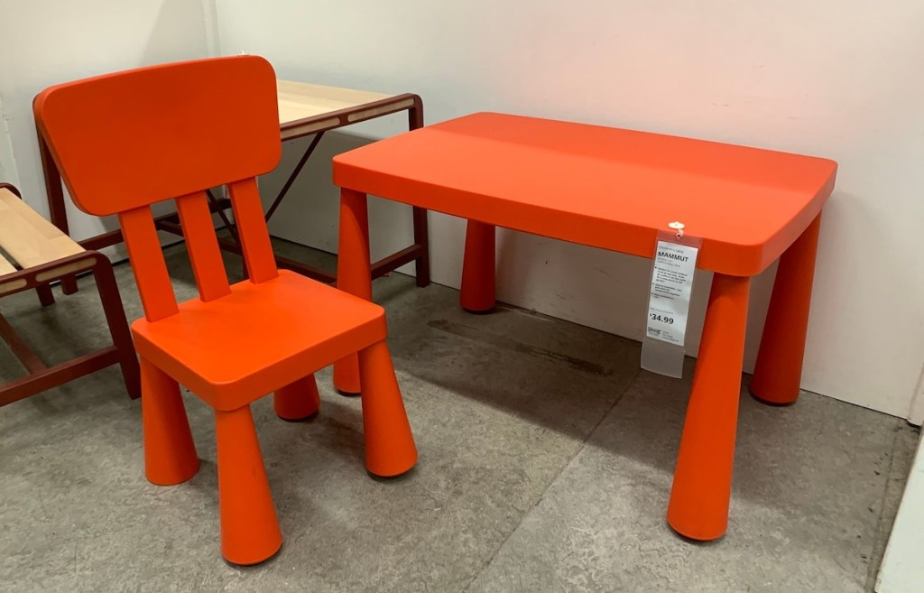 red plastic chair and table at IKEA store