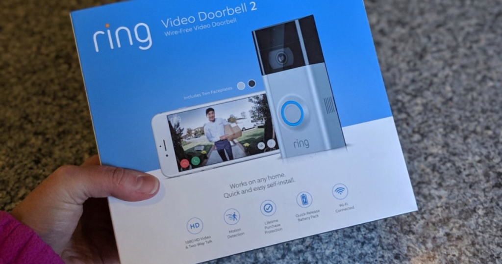 hand holding ring video doorbell 2 box