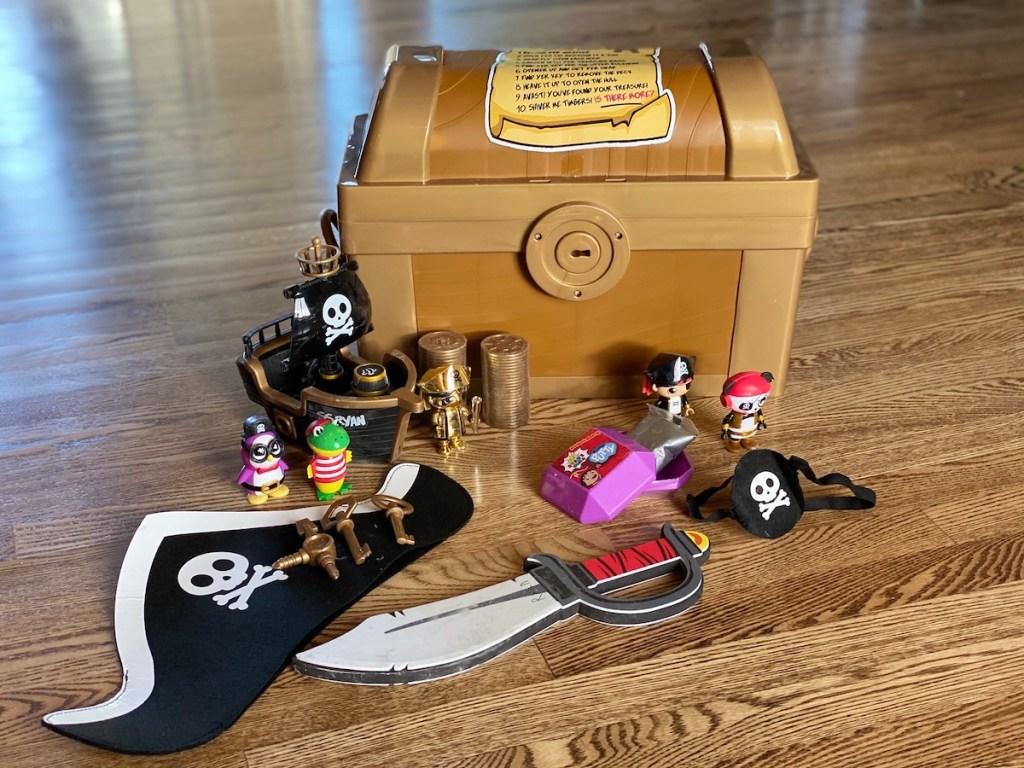 ryans treasure chest with plastic toys on wood floor