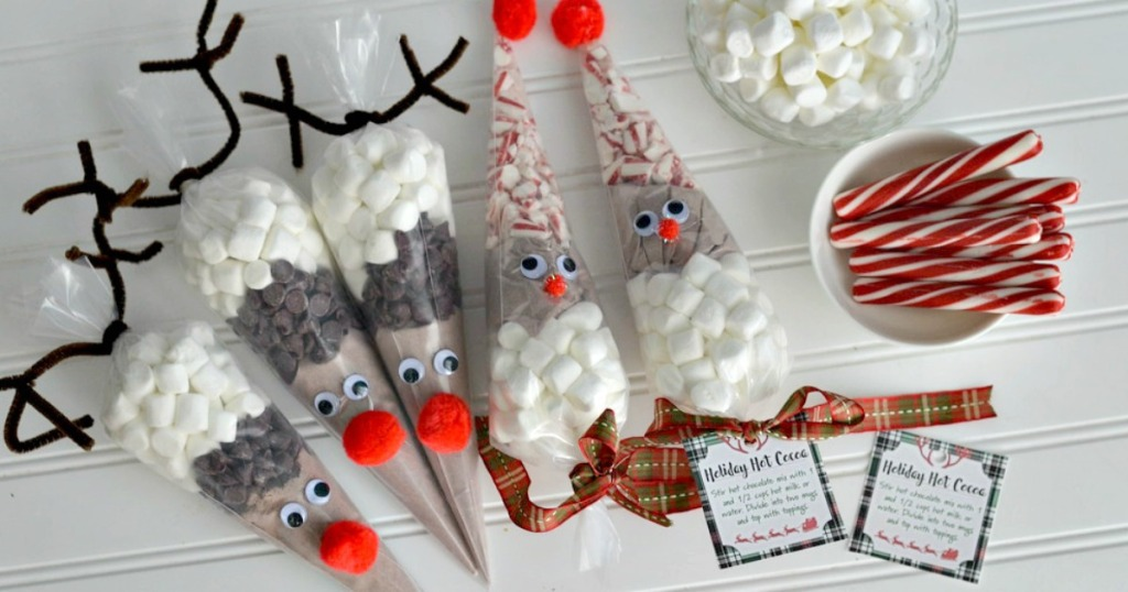 reindeer bags with hot cocoa ingredients inside for frugal christmas traditions neighbor idea