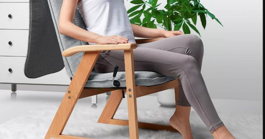 woman sitting in Sharper Image massage chair