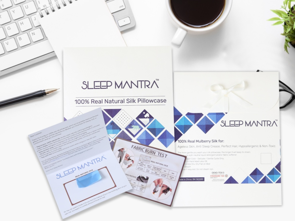 sleep mantra cards by cup of coffee and keyboard on desk