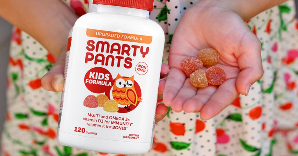 smarty pants kids formula girl holding bottle and vitamins in hand