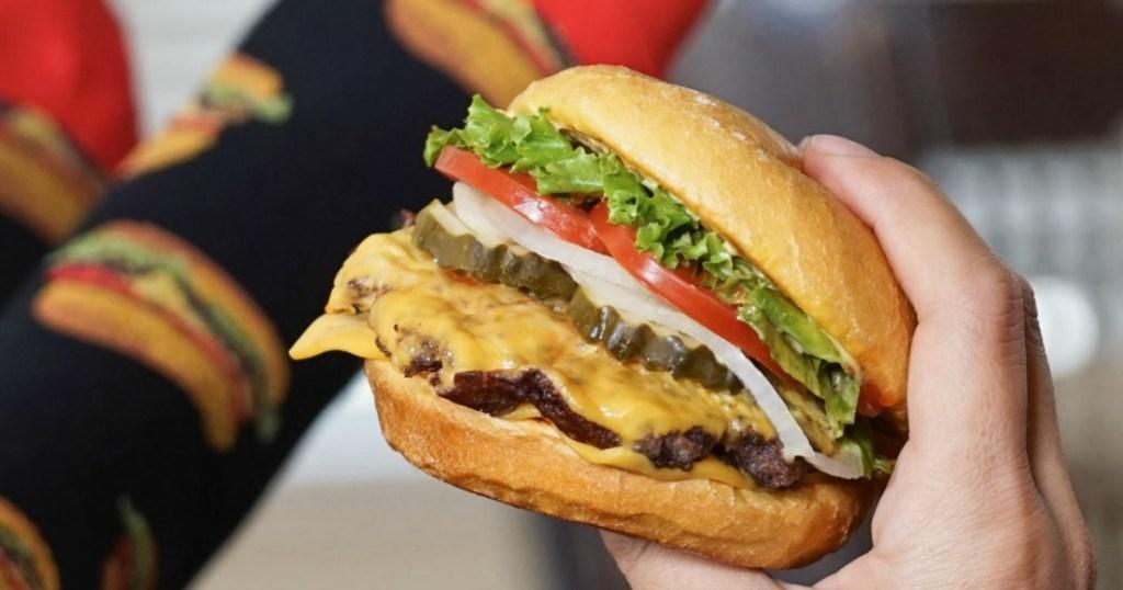 holding Smashburger
