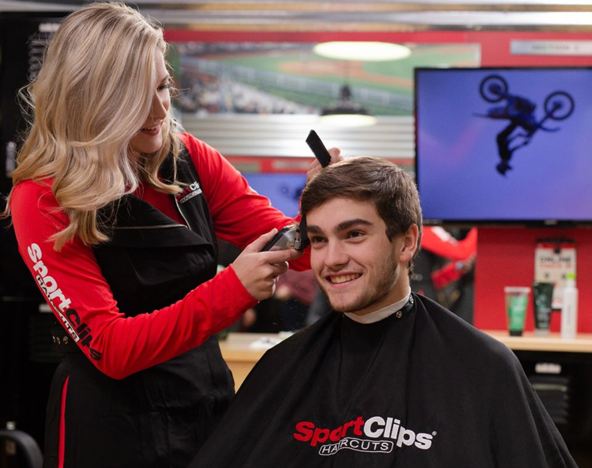 man getting haircut at Sport Clips