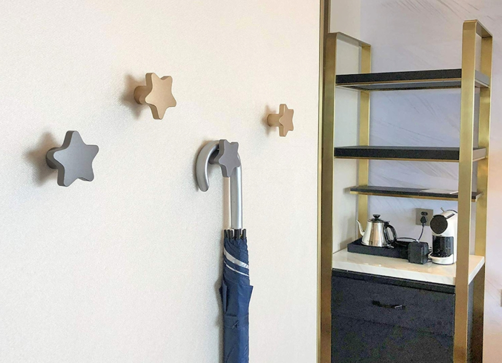 star shaped metal silver and gold wall knobs hooks on wall