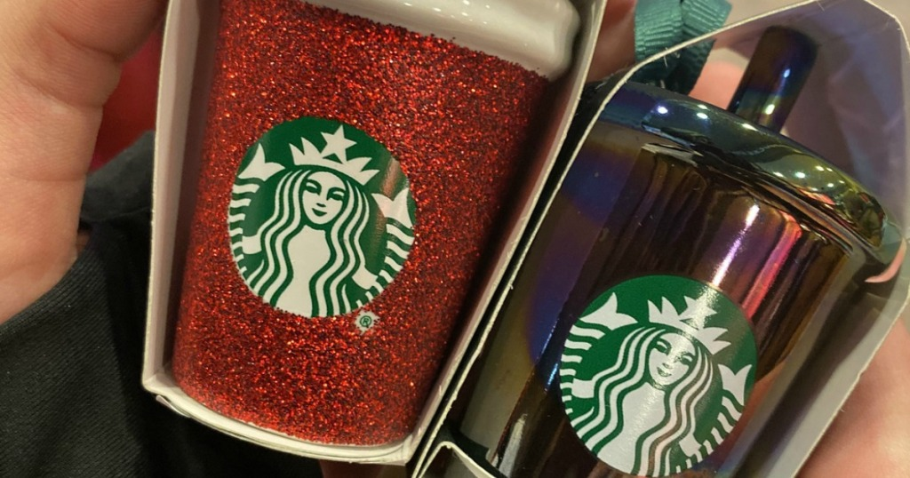Starbucks cup Christmas ornaments held in hand