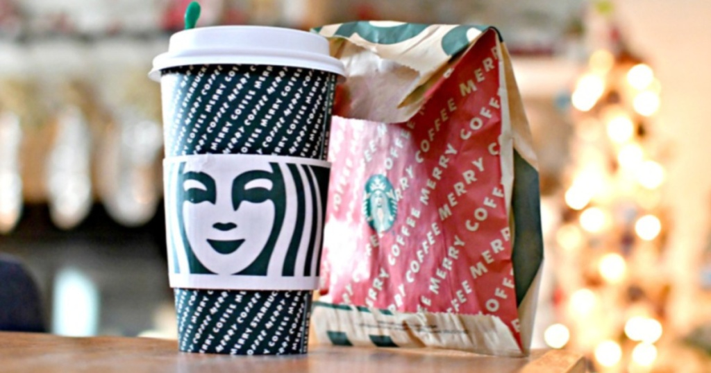 starbucks drink and food bag with christmas decor in background