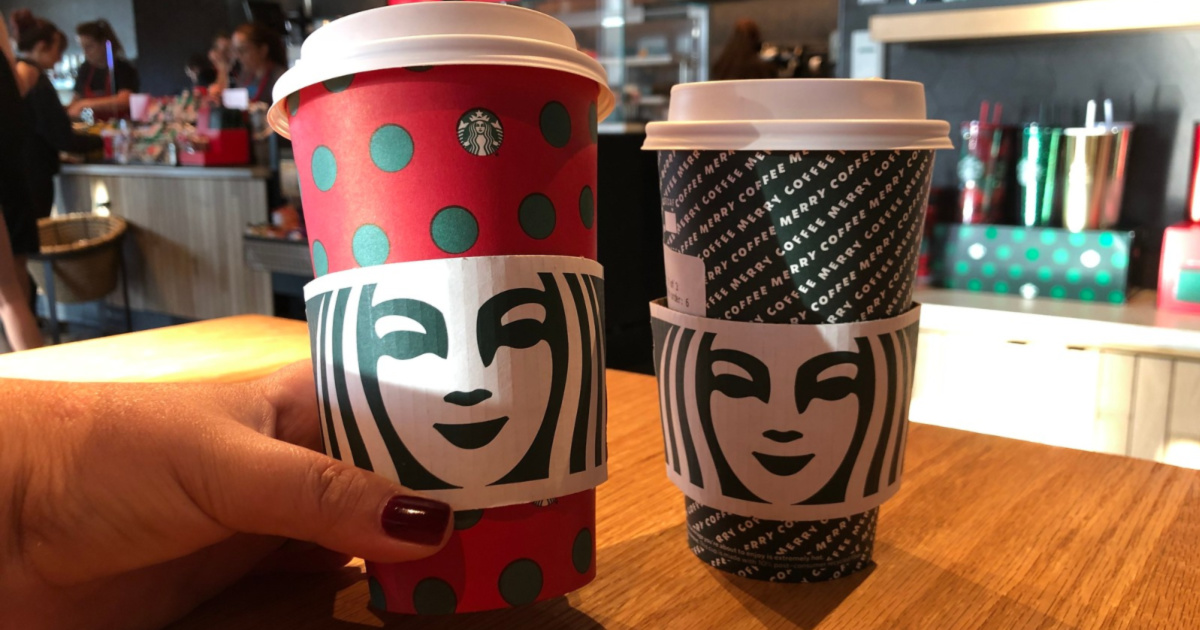 two Starbucks drinks in holiday cups on table