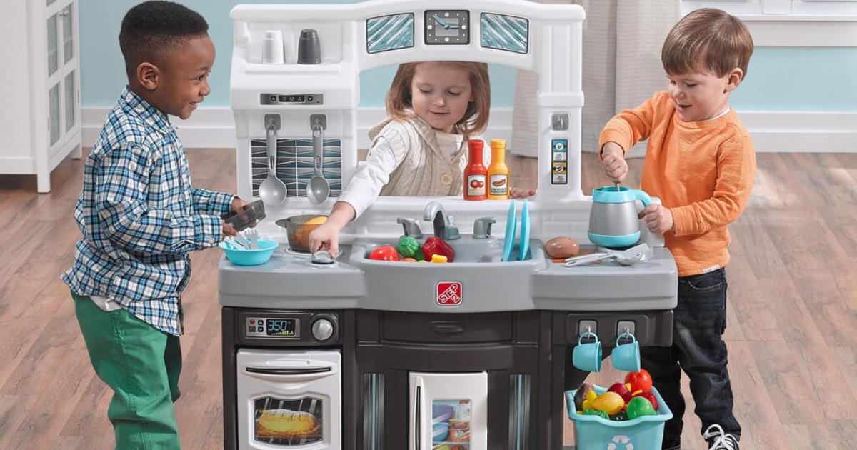 kids playing with kitchen set