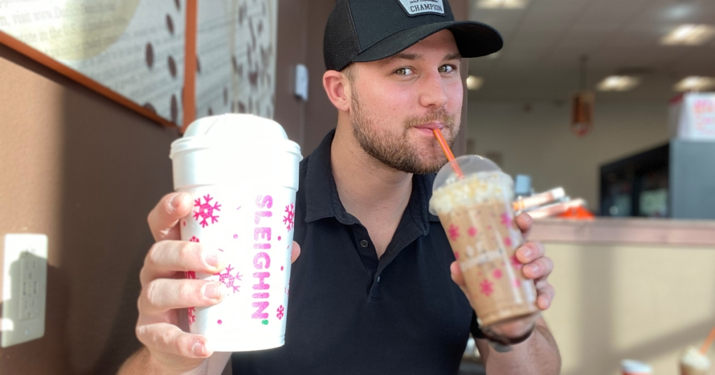 Stetson drinking 2 Dunkin holiday beverages