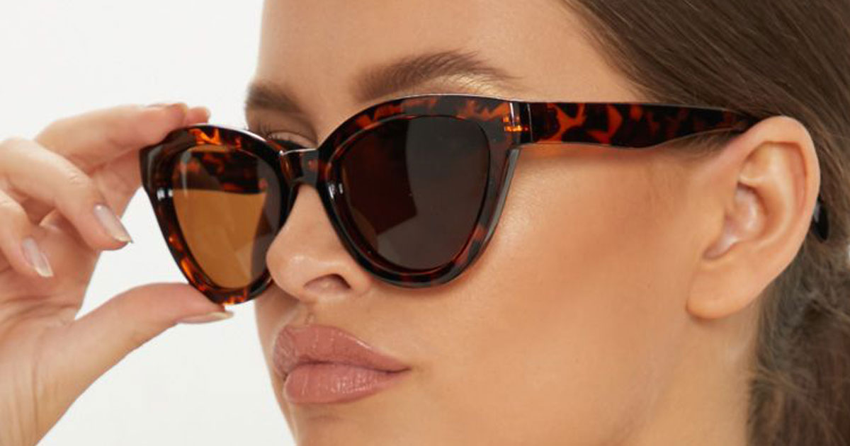 lady wearing pair of Tory Burch Black Tortoise Round Sunglasses with Gradient Lens