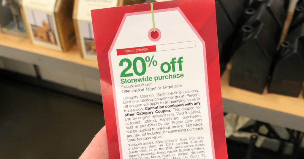 person holding Target 20% off coupon