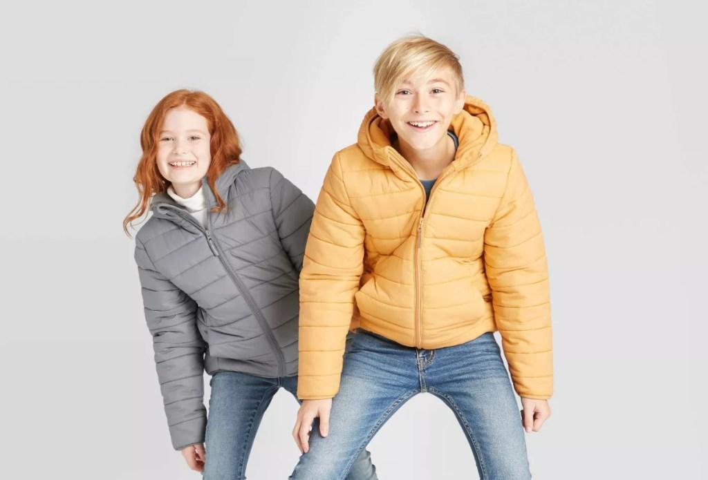 2 kids wearing puffer jackets