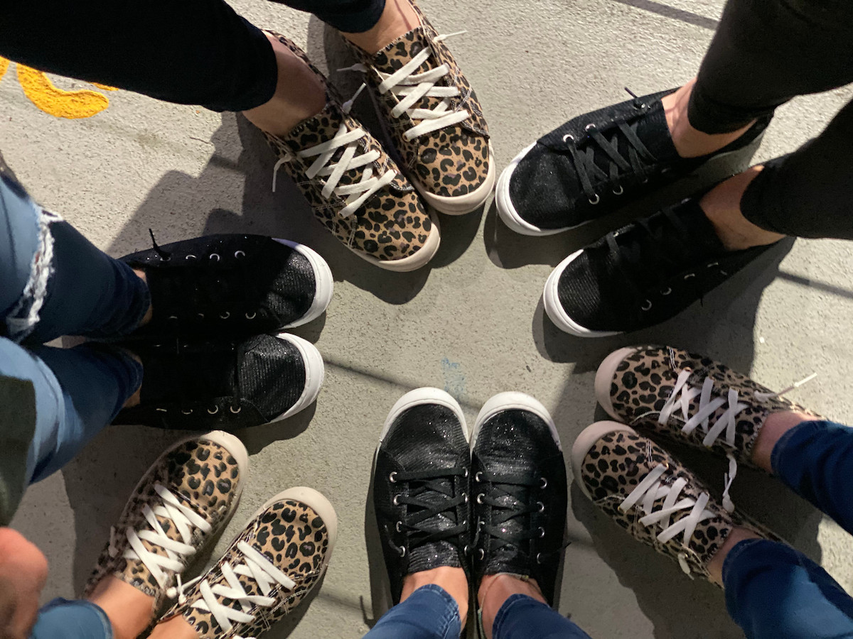 team wearing shoes standing on concrete