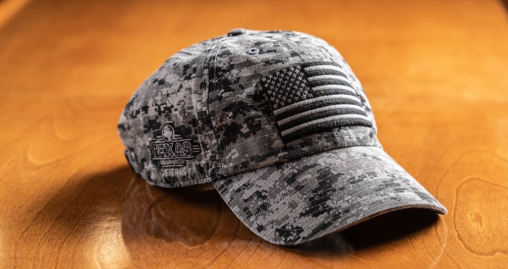 Texas Roadhouse Military hat on table