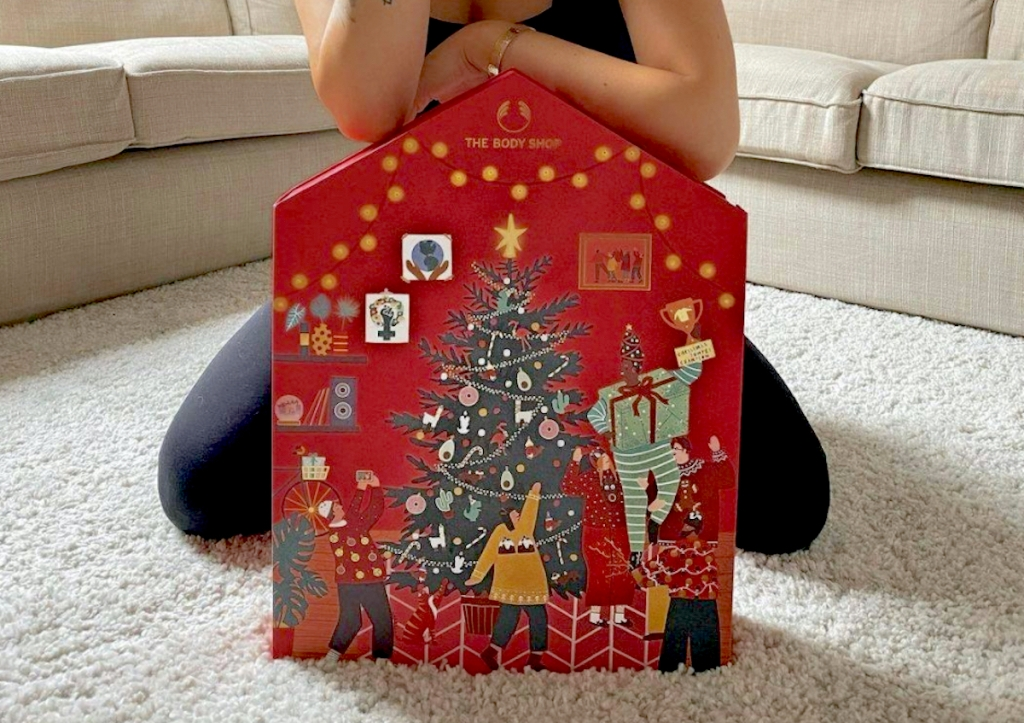 person with arms on top of the body shop beauty advent calendar