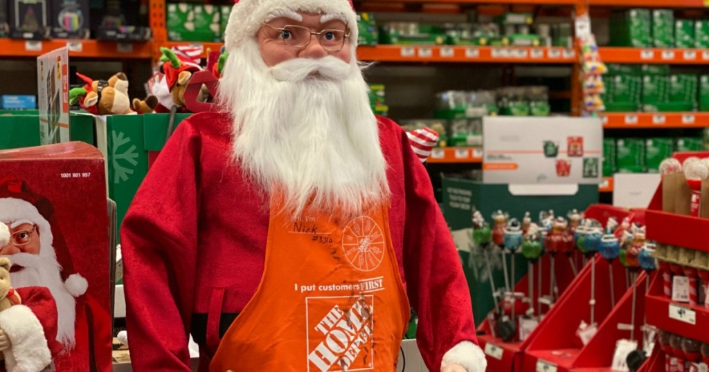 fake santa wearing a Home Depot apron