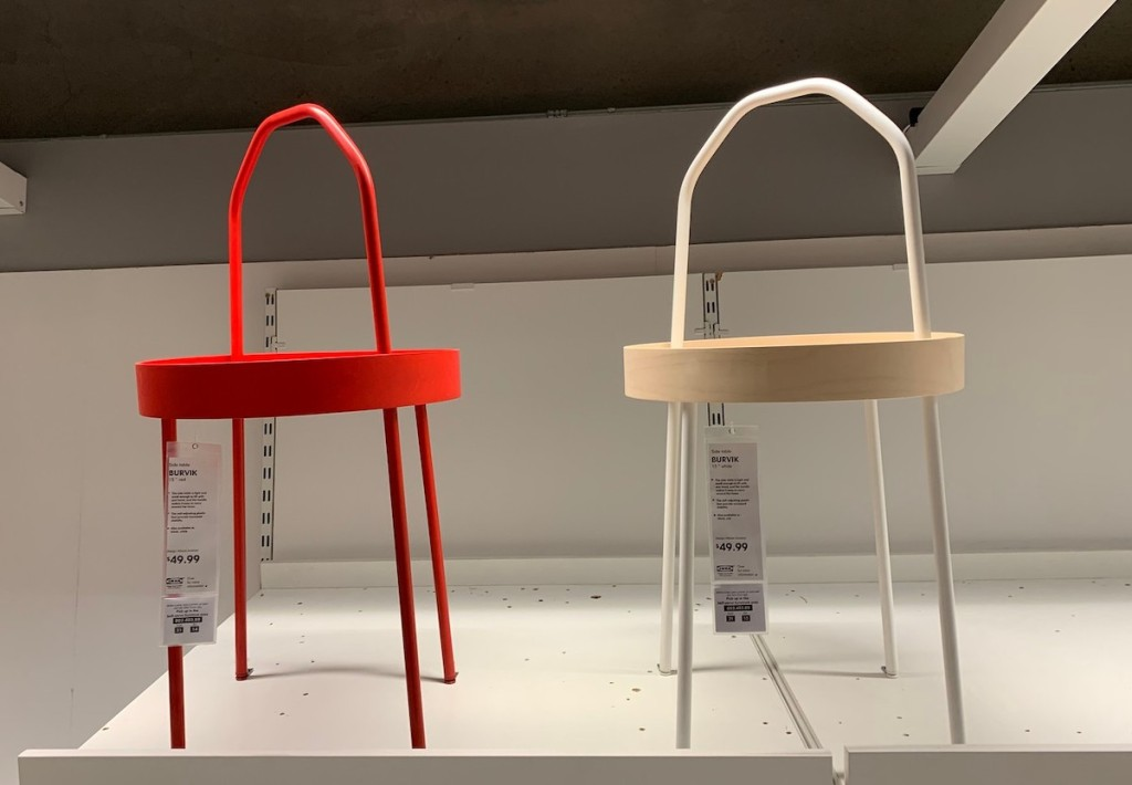 red and white natural wood side tables with handles on store shelf