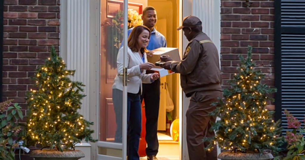 UPS delivering package to home at the holidays