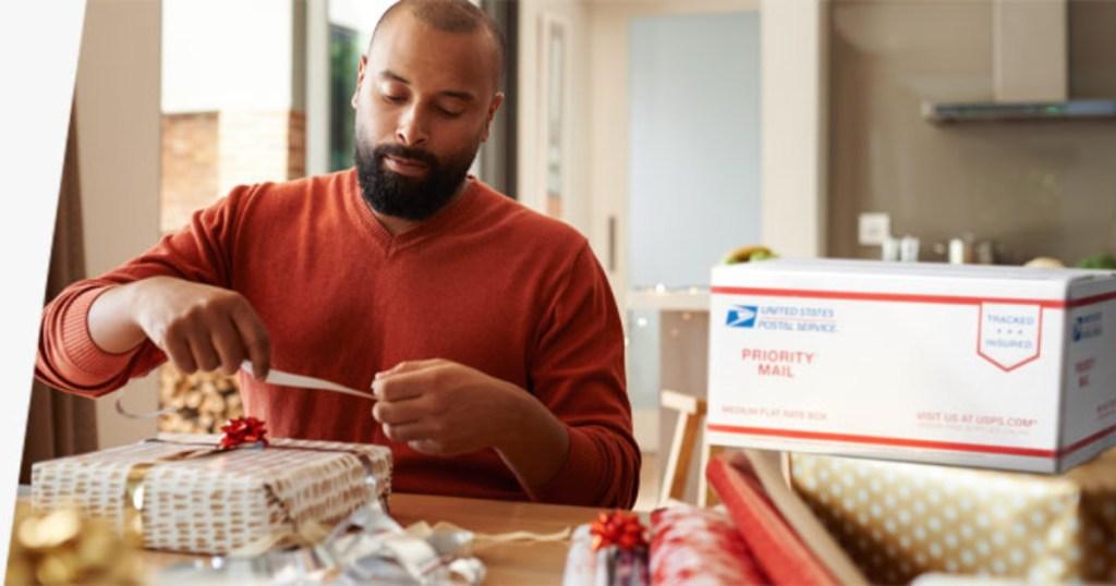 Man wrapping gift to ship via USPS