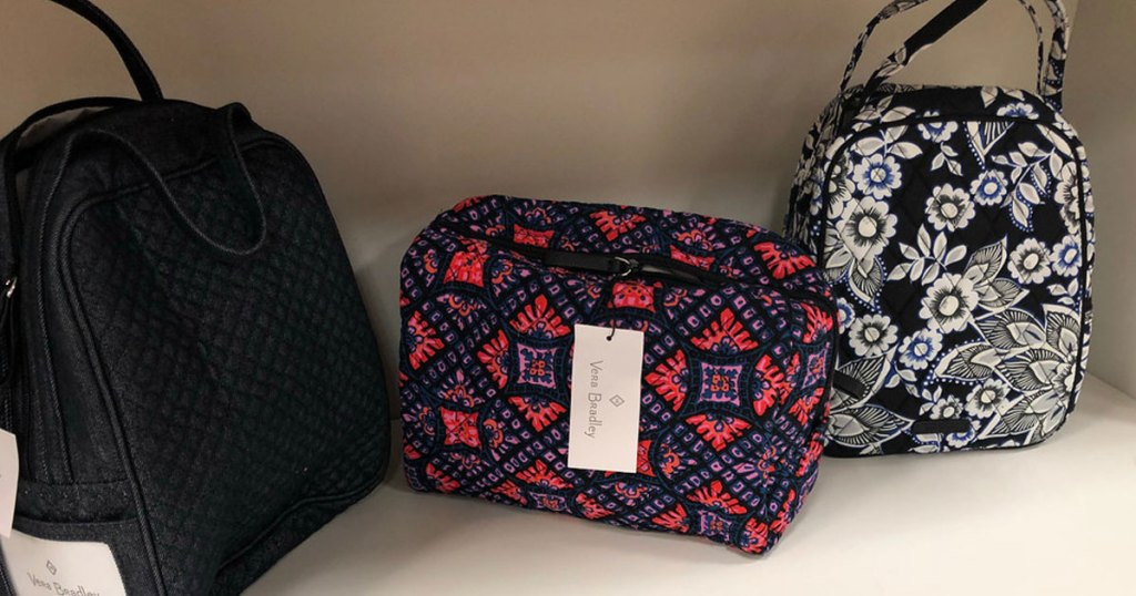 vera bradley cosmetic bag on shelf with other bags in store