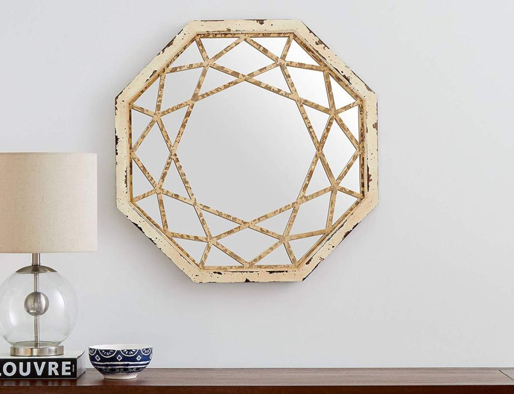 octagon shaped mirror hanging on gray wall
