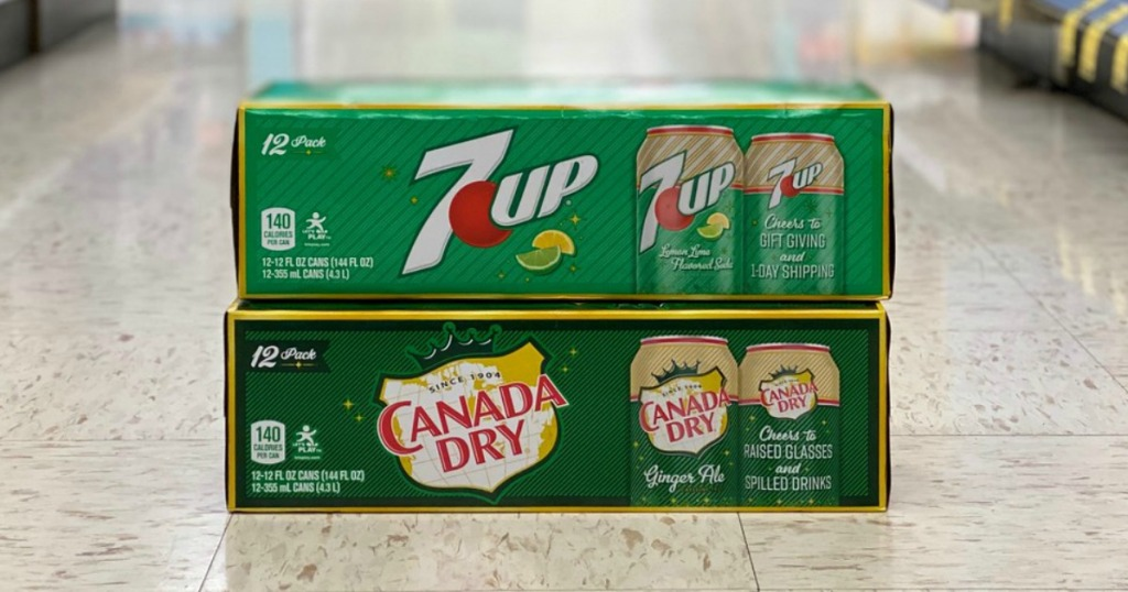 7up and canada dry 12-packs of soda on the floor in store
