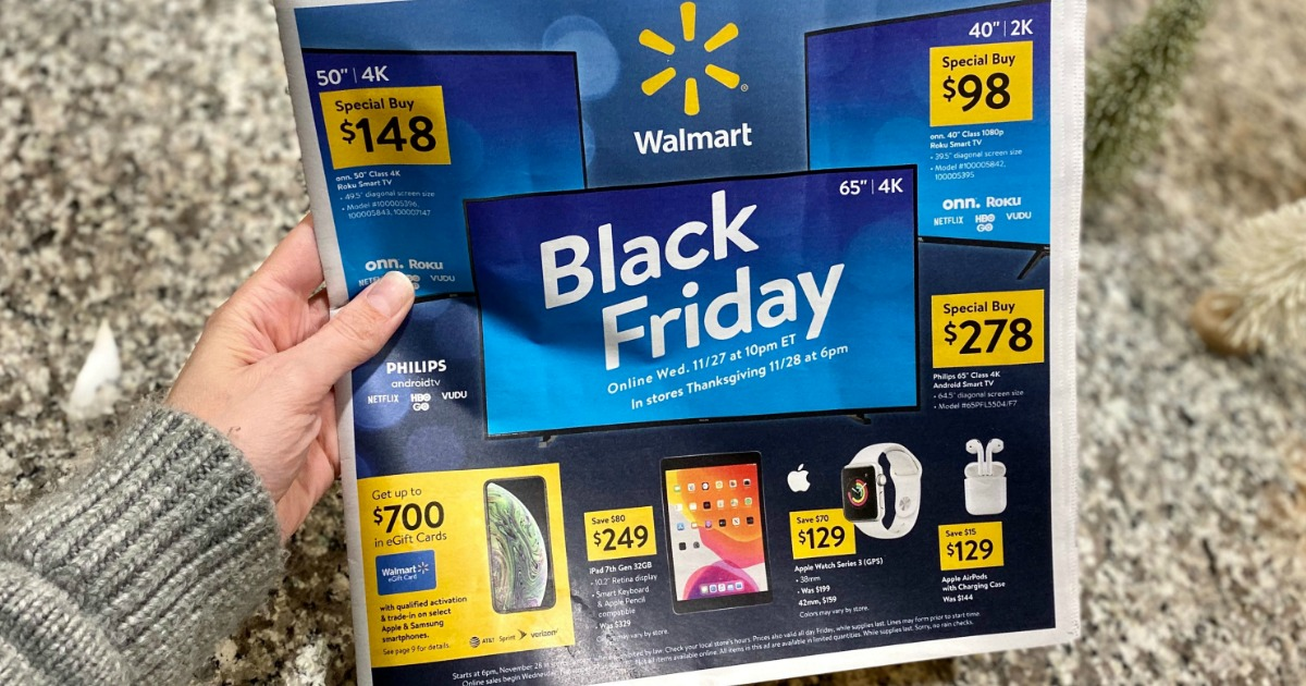 hand holding Walmart Black Friday 2019 ad