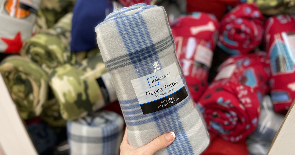 mainstays fleece throws hand holding a plaid one