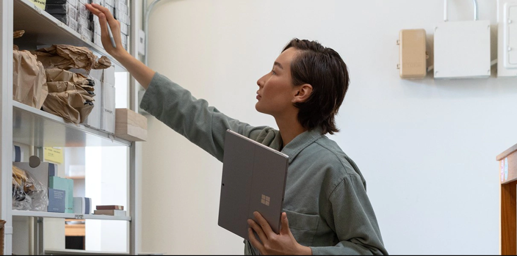woman holding Surface Pro 7