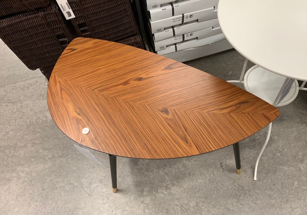 leaf shaped end table with brown and black wood grain