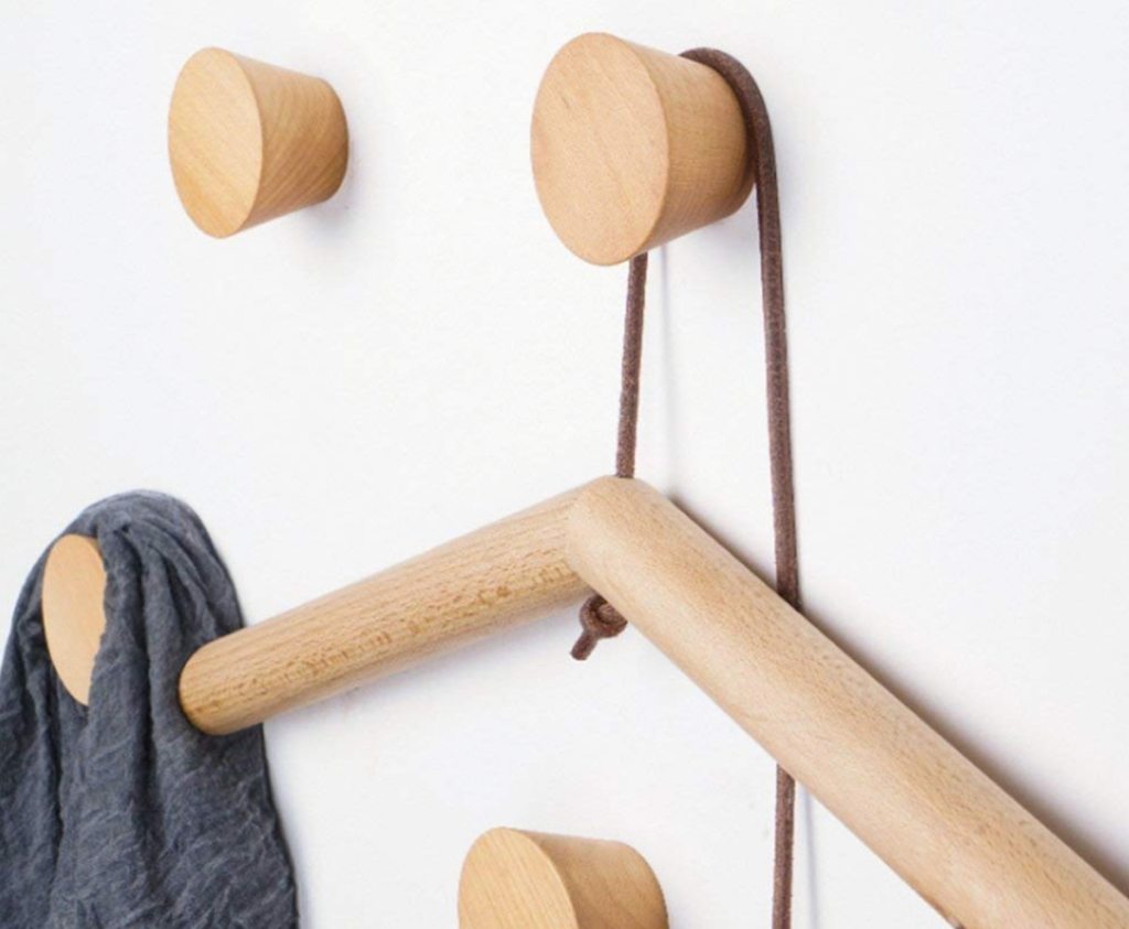 close up of natural wooden wall knobs with wooden hanger and scarf hanging