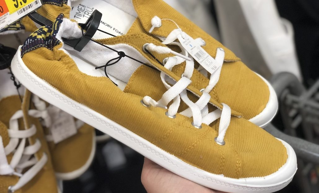 yellow pair of time and tru shoes on store shelf