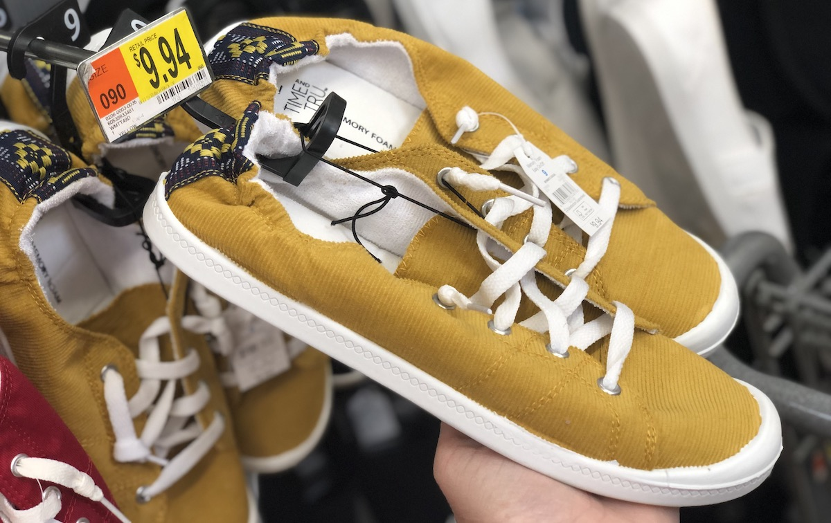 yellow pair of sneakers on store shelf