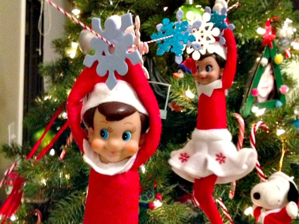 ziplining elves on a christmas tree
