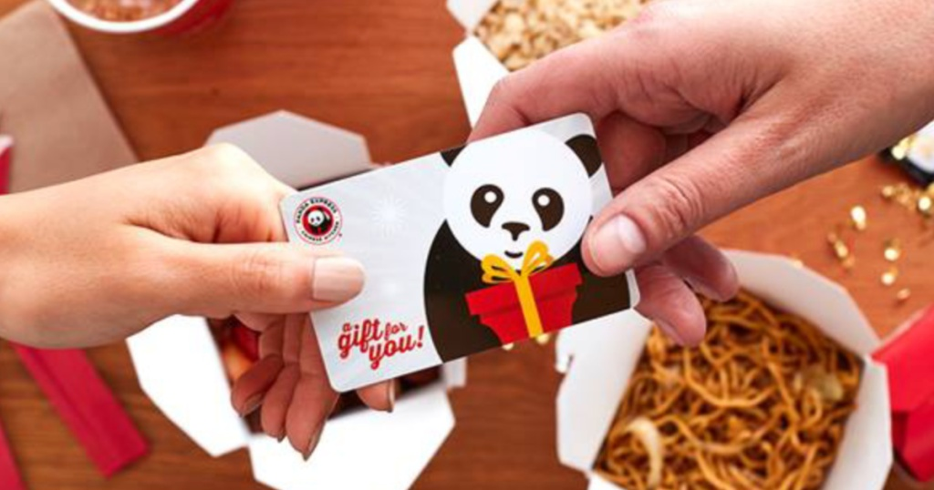 Hands holding Panda Express gift cards
