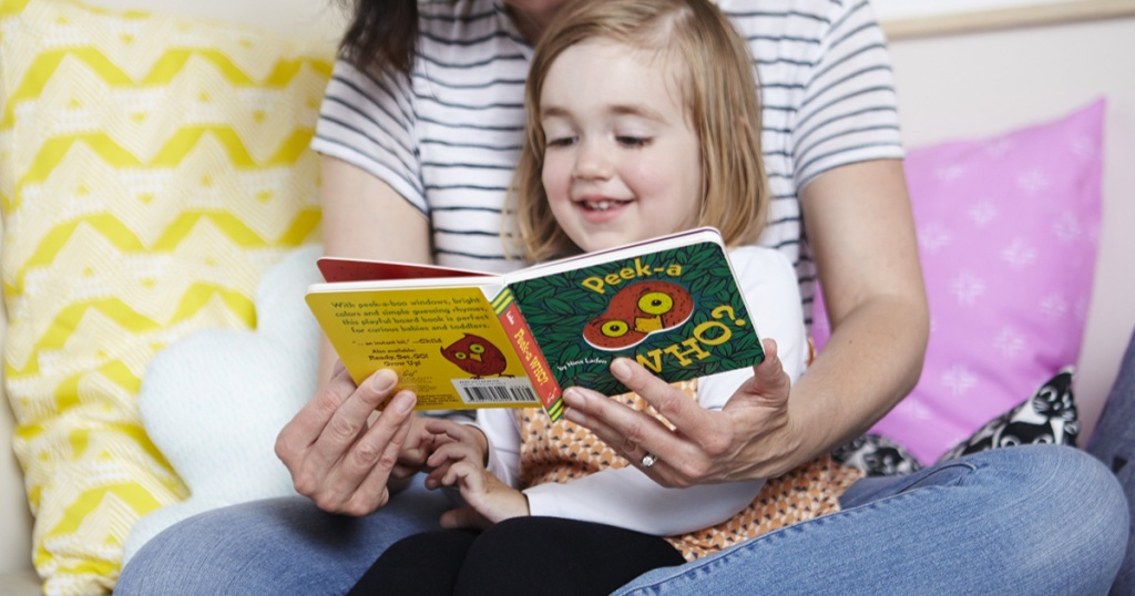 Woman and little girl reading Peek-A-Who board book