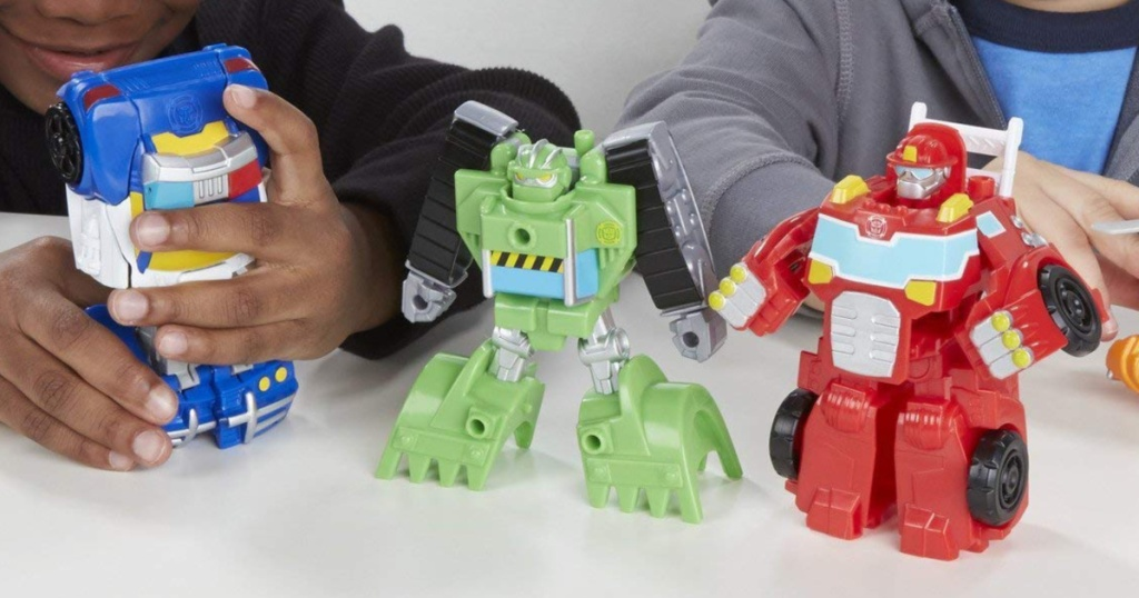 Kids playing with Playskool Transformers Rescue Bots