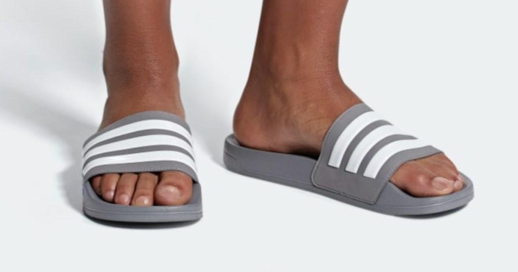 man wearing Men's Adidas Adilette Slide
