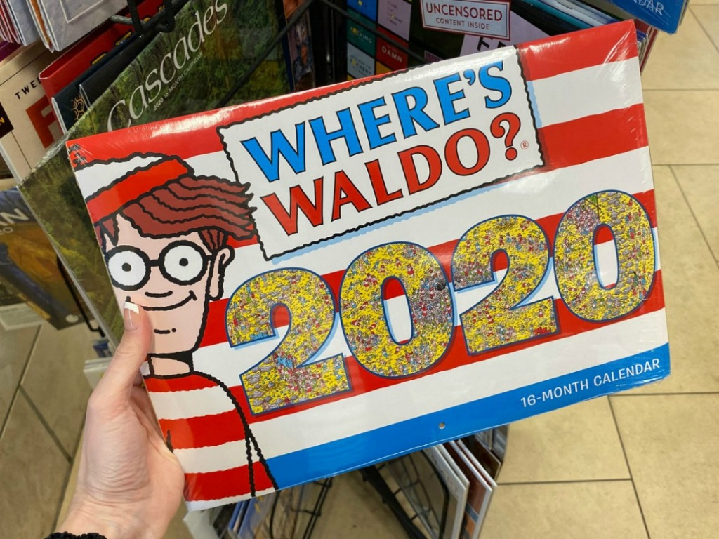 Hand holding a 2020 Wheres Waldo 16-Month Wall Calendar in store