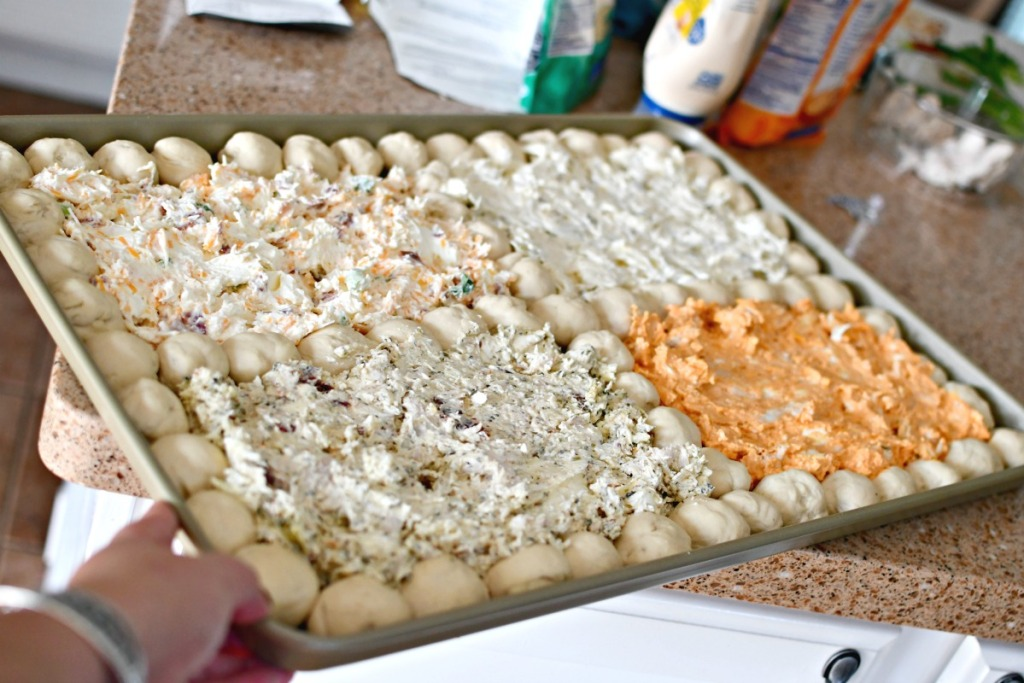 4 dips and pizza balls ready for the oven