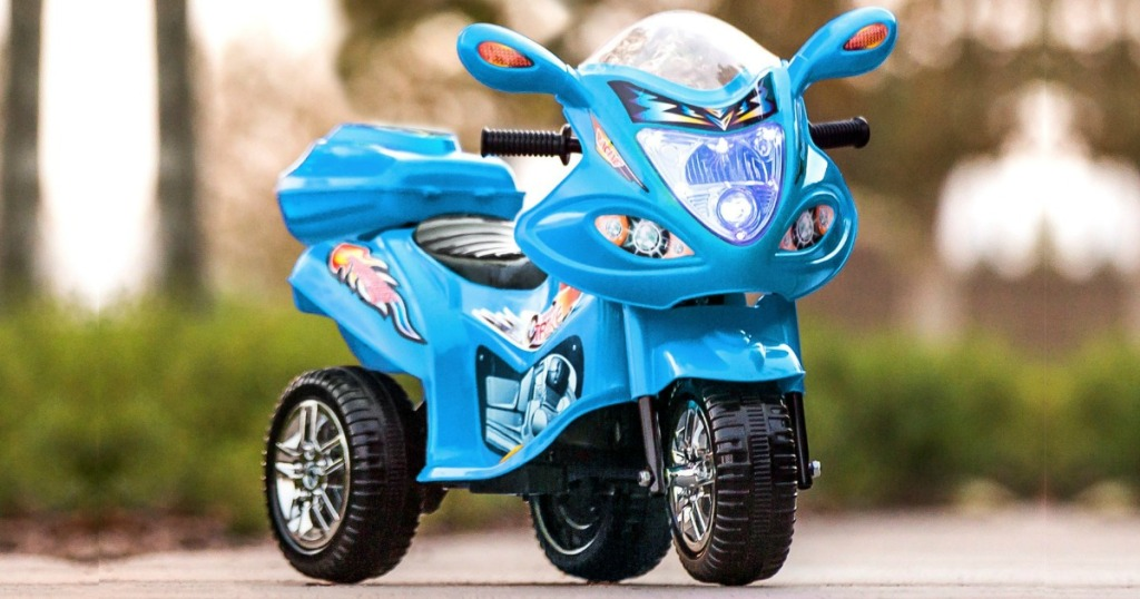 Blue kids motorcycle outdoors