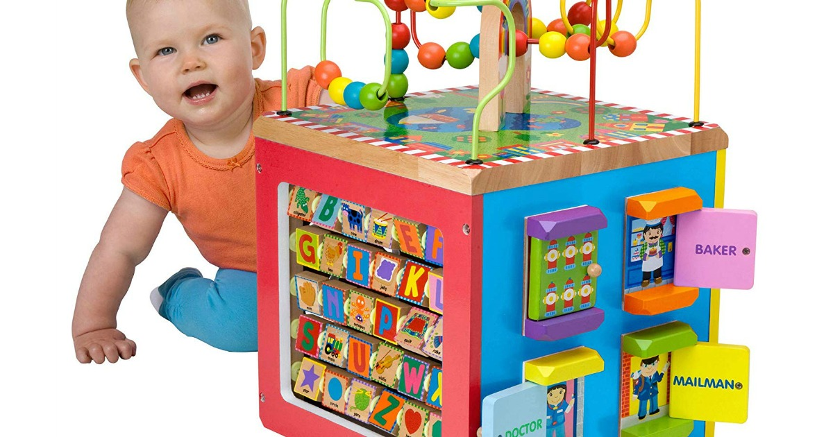 baby playing with activity cube