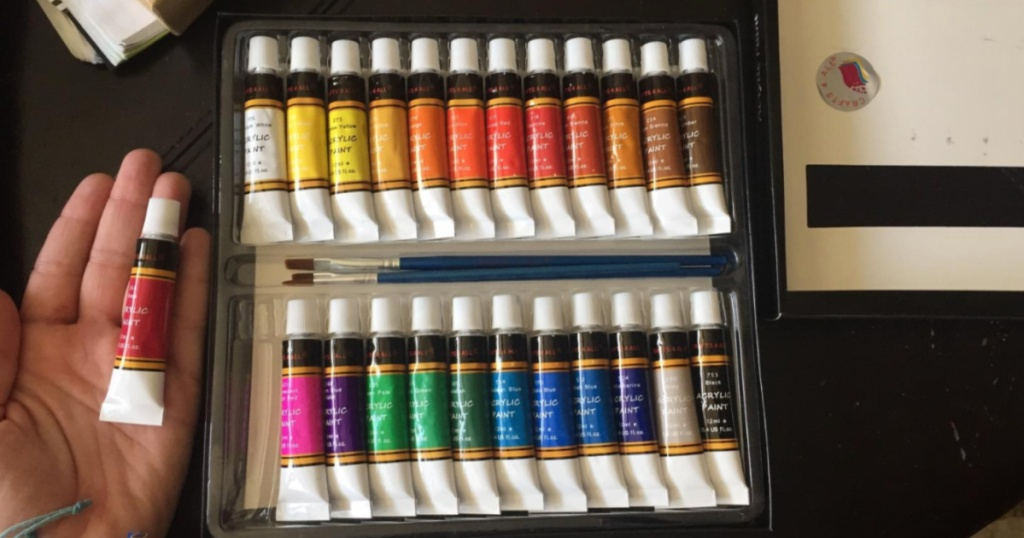 Acrylic Paint Set with pink paint in hand