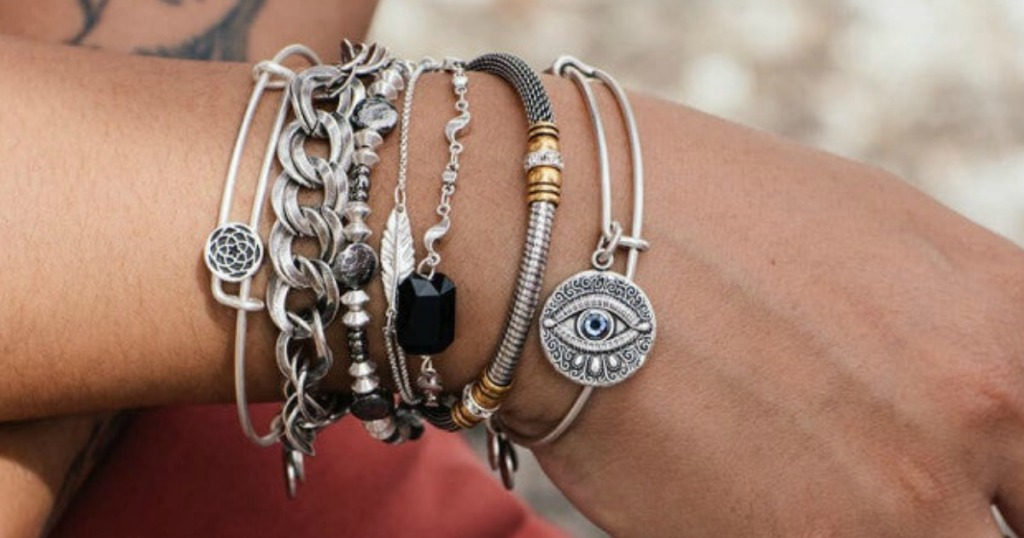 Alex and Ani Charm Bracelets on a ladies arm