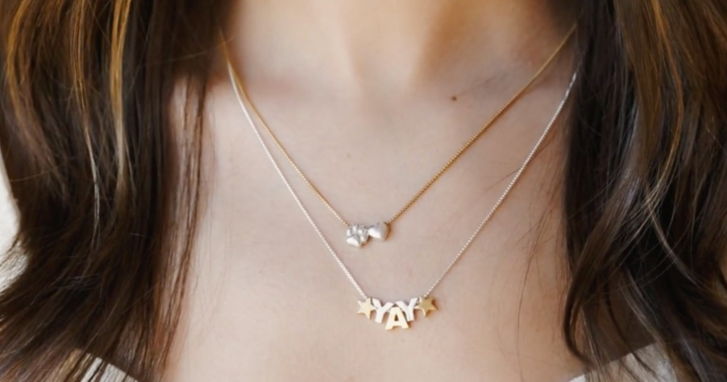 woman wearing Alex and Ani Personalized Styles necklaces
