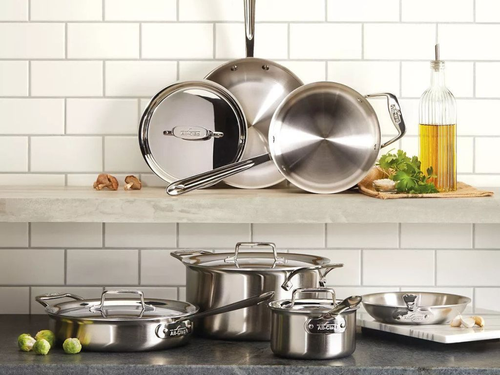 All-Clad D5 Stainless Brushed 10-Piece Cookware Set on shelf and counter top in kitchen