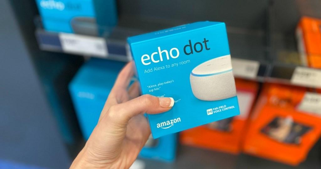 Woman holding Amazon Echo Dot